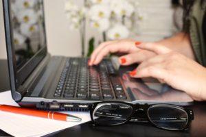 person-woman-desk-laptop-medium